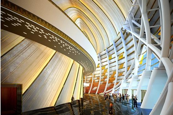 """建筑外立面形态灵感取自""""碧海银螺"""",透过玻璃幕墙可见如银螺内心一般"""
