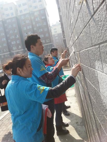 """长春万达影城举办""""社区清道夫""""义工活动"""