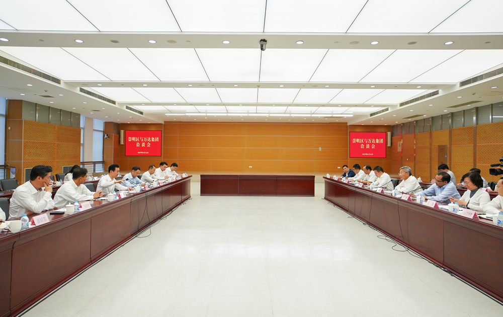 上海崇明区委书记唐海龙会见王健林董事长