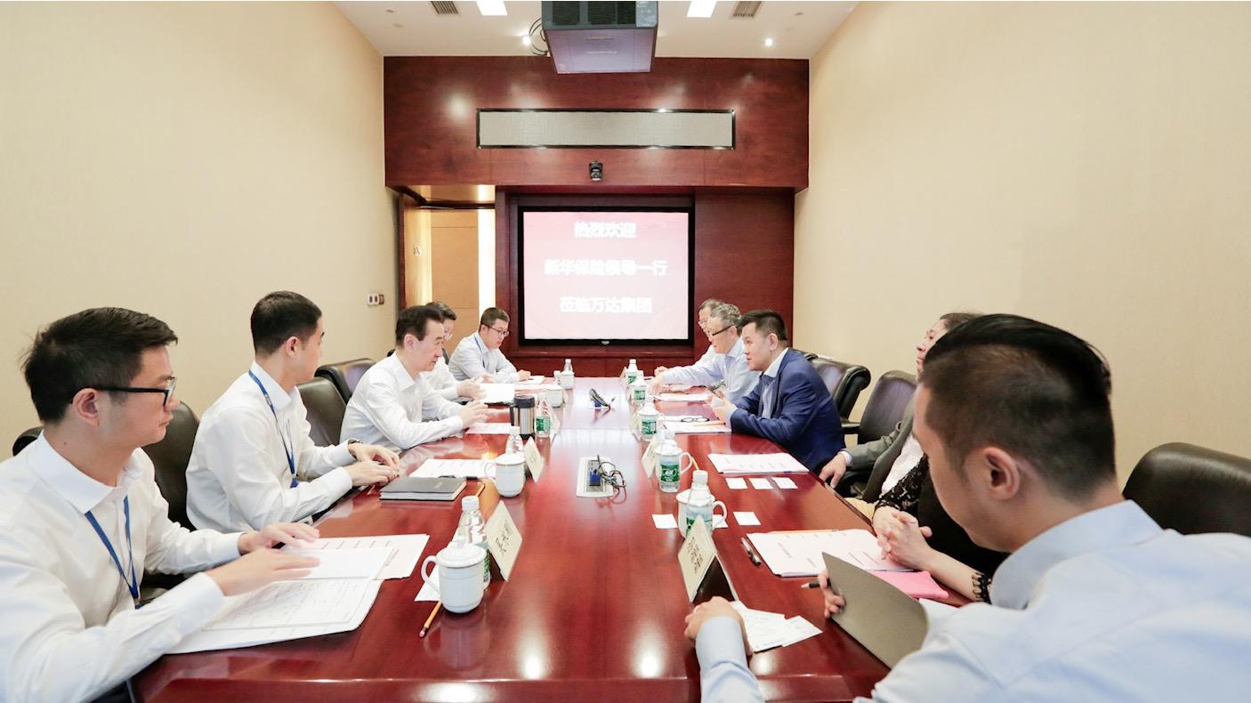 王健林董事长会见新华保险总裁李全一行